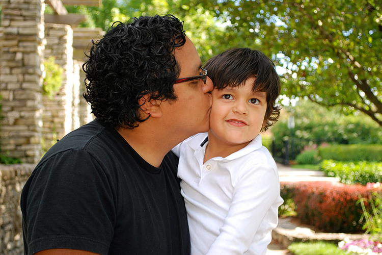 bigstock-Hispanic-father-kissing-his-ad-8203140